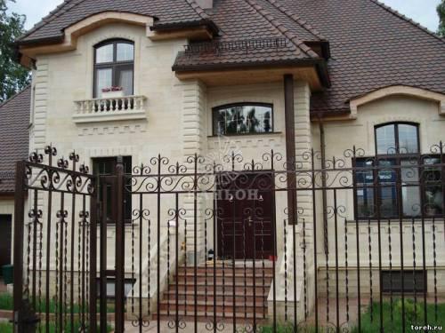 Фасады домов из камня